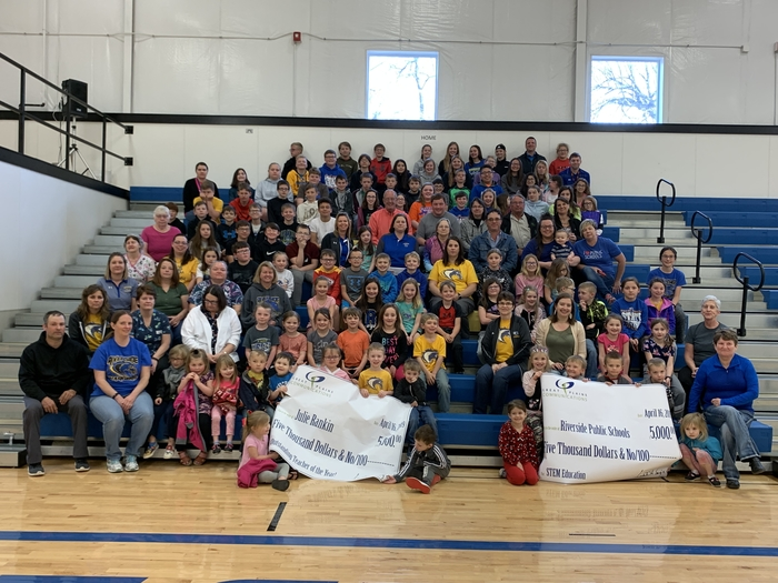 Whole school with Great Plains Communication Banner.