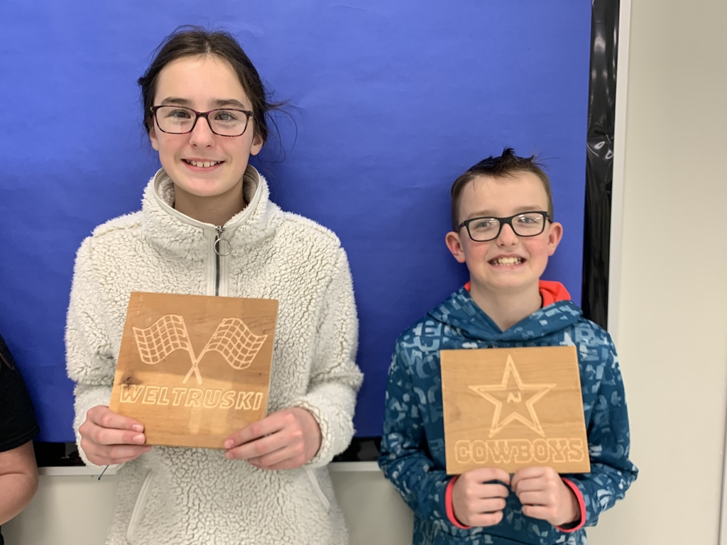 Tessa and Aj with their engravings.